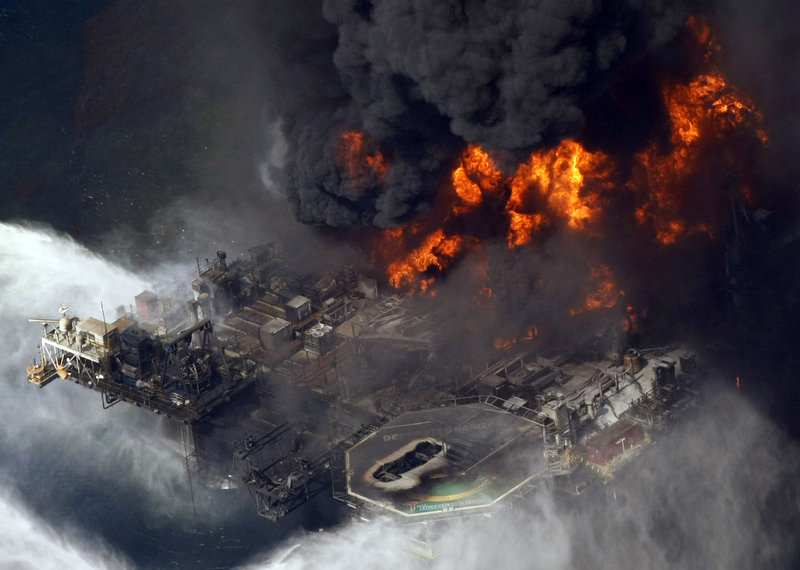 The Deepwater Horizon oil rig is engulfed in flames in this April 21, 2010, photo taken in the Gulf of Mexico. A governmental panel found Wednesday that BP was not the only entity at fault for the worst offshore oil spill in U.S. history, but bore most of the blame for its faulty decisions during the disaster and its lack of attention to safety before the blowout occurred.