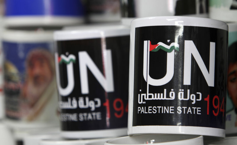 Cups designed as part of the campaign promoting the Palestinians bid for statehood are displayed in a souvenirs shop in Gaza City,