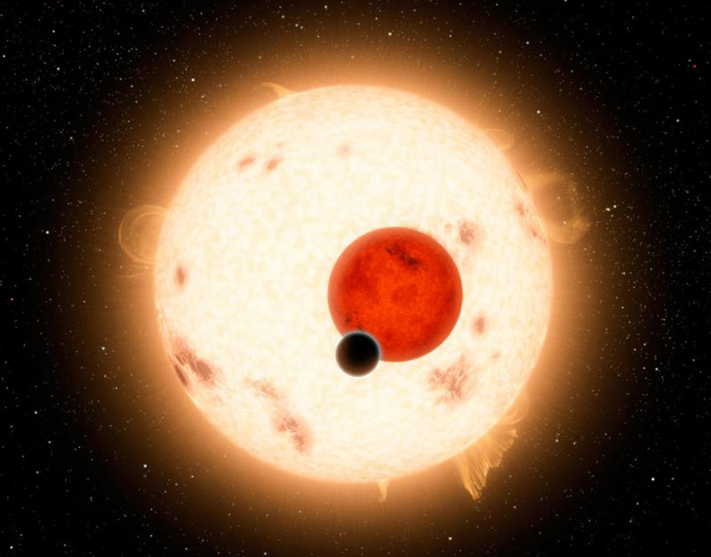 Artist's depiction shows the planet Kepler 16B, a world where two suns set over the horizon instead of just one.