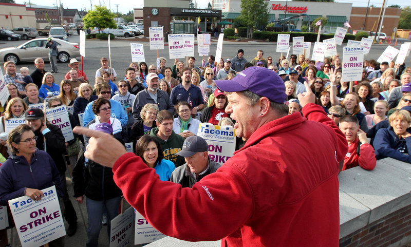 Dave Baughman cheers on striking teachers in Tacoma, Wash., on Thursday. Teachers in Washington state's third-largest school district voted overwhelmingly to remain on strike, in defiance of a judge's order that they return to work.