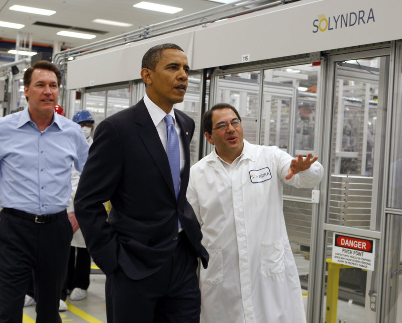 President Obama is given a tour of Solyndra in May 2010 by Executive Vice President Ben Bierman, right, and CEO Chris Gronet. Emails show a White House official dismissed reports about the solar company's gloomy future.