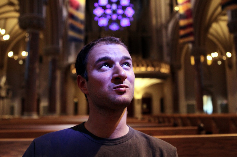 """Rocco Palmo, writer of """"Whispers in the Loggia,"""" poses for a portrait last year at St. Francis Xavier College Church in St. Louis. He's known for getting the inside scoop on a notoriously secret institution."""