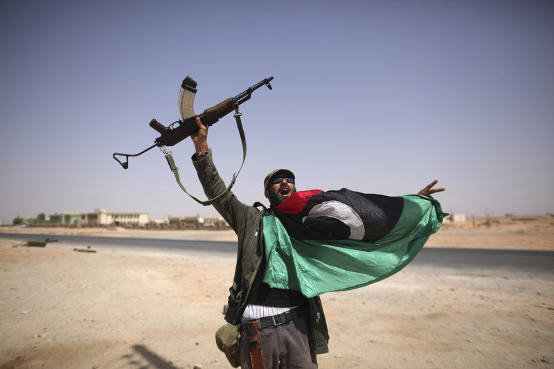 A Libyan fighter celebrates in Bani Walid, Libya, Friday. Libyan fighters are streaming into Bani Walid, one of the remaining bastions of ousted leader Moammar Gadhafi, in a new fierce push.