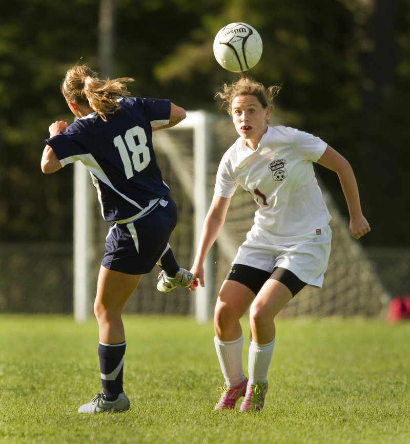 Claudia Lockwood, left, of Yarmouth and Aubrey Pennell of Freeport battle for possession during Yarmouth's 2-1 victory Friday in Freeport.