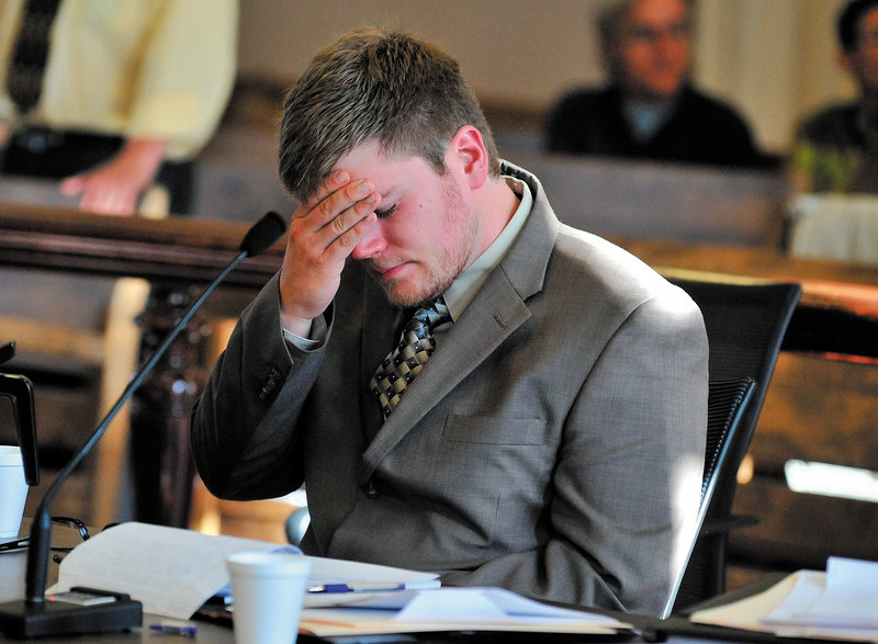 Ryan Ouimet reacts as family members recount the life and loss of Andrew Holland during sentencing at the Franklin County Superior Court in Farmington Friday.