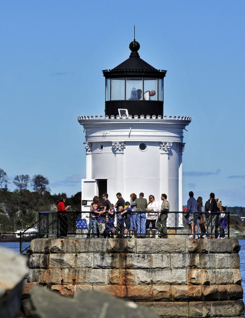 Visitors walk around Bug Light on Saturday during Open Lighthouse Day.