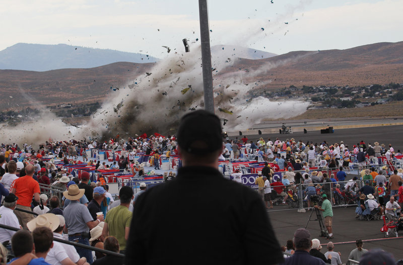 A P-51 Mustang, a World War II-era fighter plane, crashes into the edge of the grandstands at the National Championship Air Races on Friday in Reno, Nev. At least nine people died, including Jimmy Leeward, the veteran pilot of the plane.