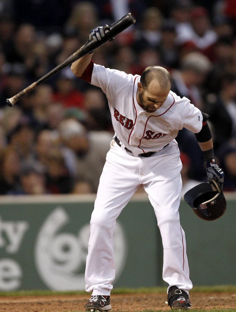 Dustin Pedroia throws his bat down after striking out to end the seventh inning. He finished 0 for 4 and the Red Sox saw their lead in the AL wild-card race cut to three games.