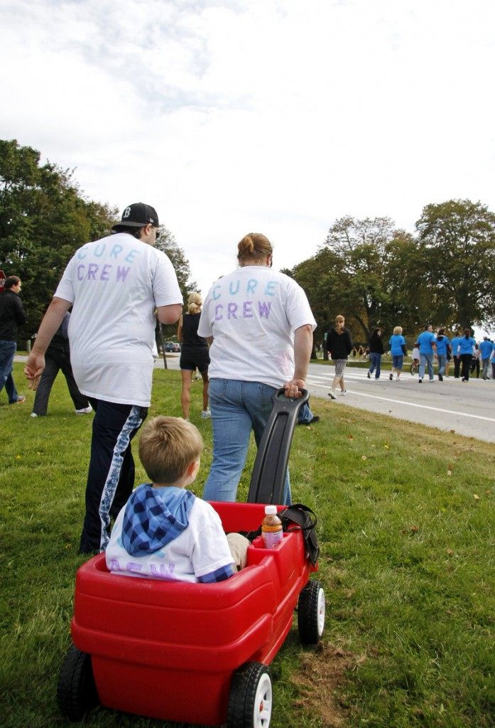Roman Dehmlow, 6, his mom, Jennifer Dehmlow, and her fiance, Jason Silva, all of Augusta, head off on the walk.