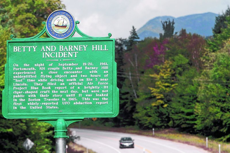 A car passes through Franconia Notch, where a state marker is seen. Betty and Barney Hill recalled through hypnosis that they were abducted by extraterrestrials here 50 years ago.