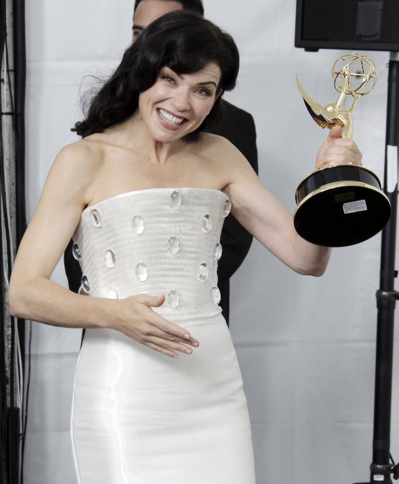 """""""The Good Wife"""" cast member Julianna Margulies shows off her Emmy for best lead actress on Sunday."""