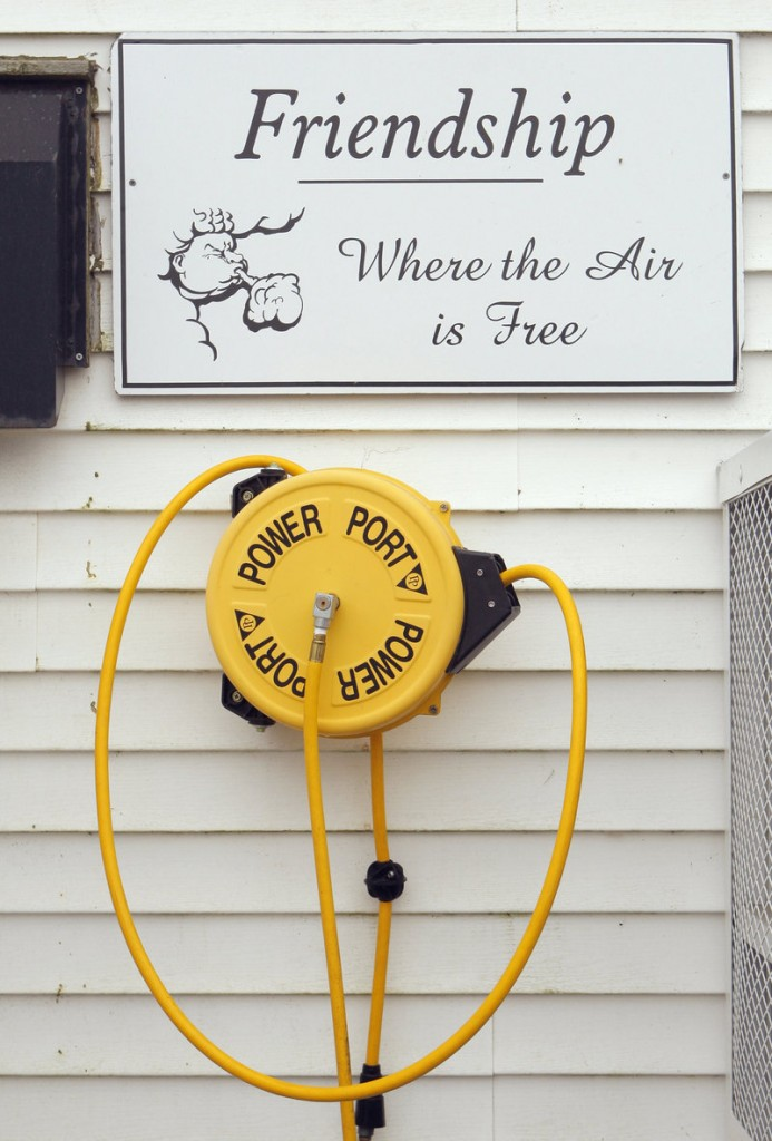 A sign outside Archie Wallace's store in Friendship lets visitors know they can fill up their car or bike tires for free.