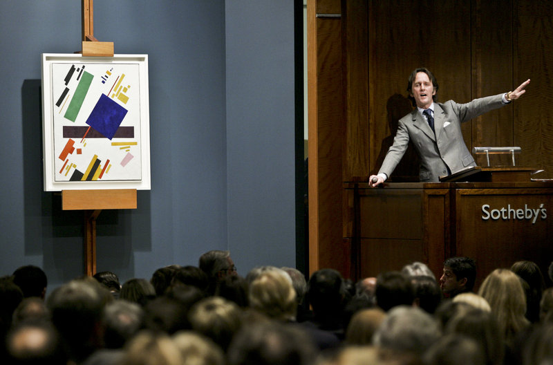An auctioneer takes bids from collectors on a painting at Sotheby's auction house in New York, a frequent destination for those who have made it financially. The United States leads the world in millionaires with an estimated 5.2 million of them in 2010, or nearly one in every 20 households.