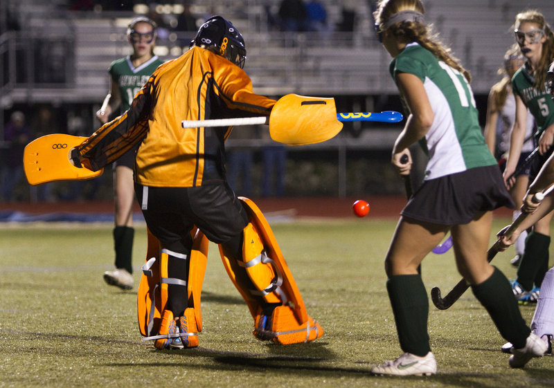 Waynflete goalie Kailina Mills keeps her eye on the ball as teammate Madison Pellow, right, looks on during Yarmouth's 4-1 win Monday.