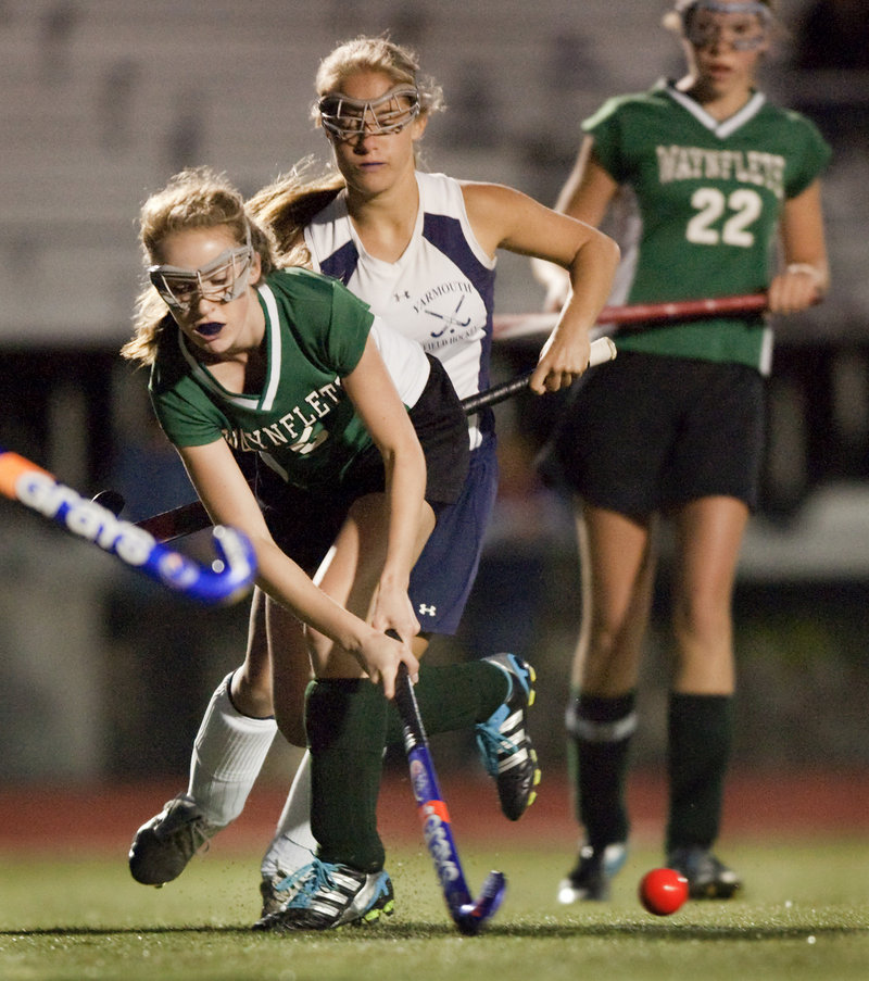 Waynflete's Alexandra Armstrong keeps the ball away from a Yarmouth player during the Clippers' 4-1 win Monday in Yarmouth.