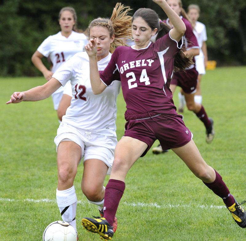 Leah Young of Greely attempts to knock the ball away from Jess Hench of Freeport during Greely's 3-0 victory Tuesday at Freeport High. The Rangers improved to 5-1. Freeport is 3-4.