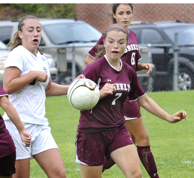 Gabby Morris of Greely looks to get the inside track to the ball ahead of Helen Humphrey of Freeport in their Western Maine Conference girls' soccer game.
