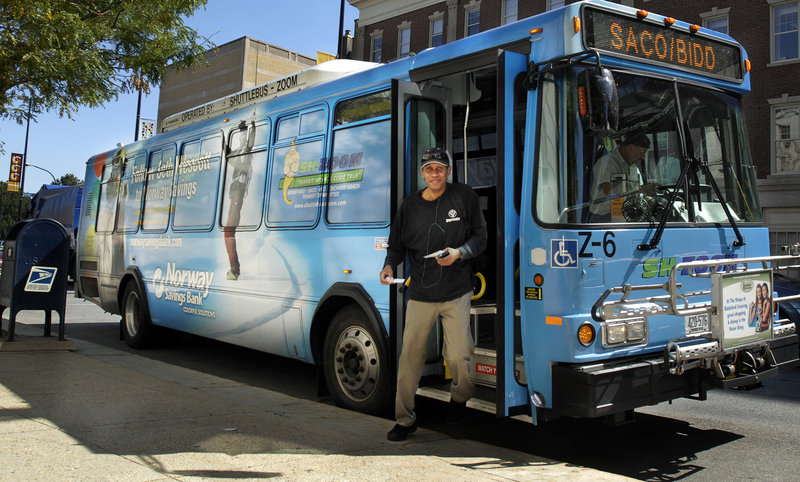 A man exits the Zoom bus at Portland City Hall on Wednesday. Ridership on the service is up overall, but some routes – especially Sundays and nights – have just two to five passengers.