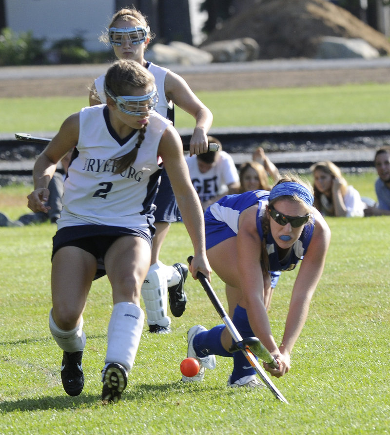Christina DiPietro of Fryeburg Academy, left, competes for the ball with Megan Fortier of Falmouth during Fryeburg's 4-1 victory Wednesday in a game matching the top two teams in Western Class B field hockey.