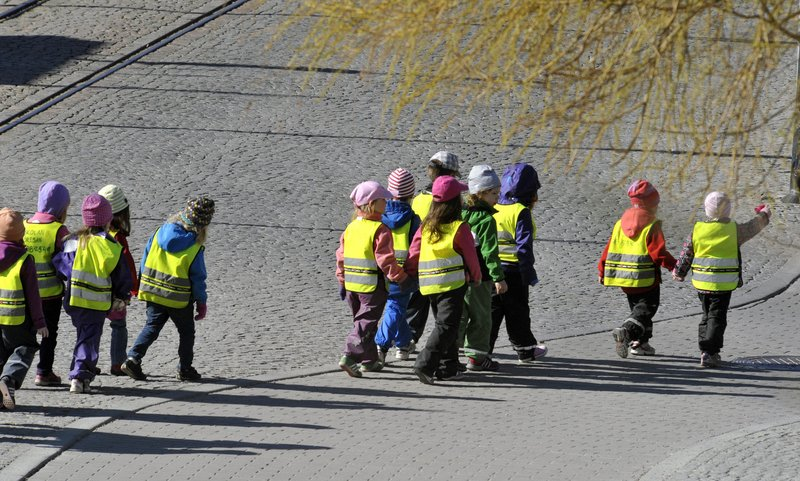 Children go for a walk at a day-care center in Stockholm. Some day-care centers in Sweden have started using electronic tracking devices to keep tabs on children during excursions