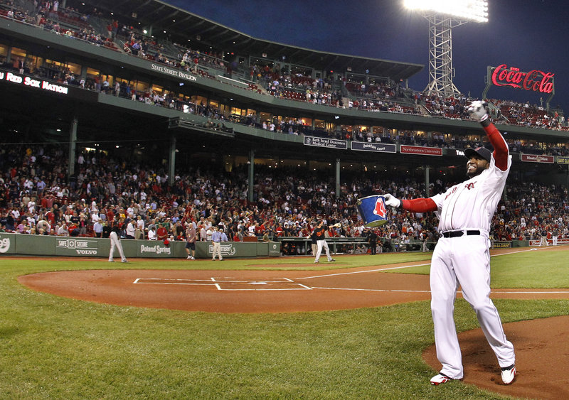 David Ortiz tosses baseballs into the stands Wednesday before the Red Sox played their final home game of the regular season. Boston blew a lead and lost to the Rays.