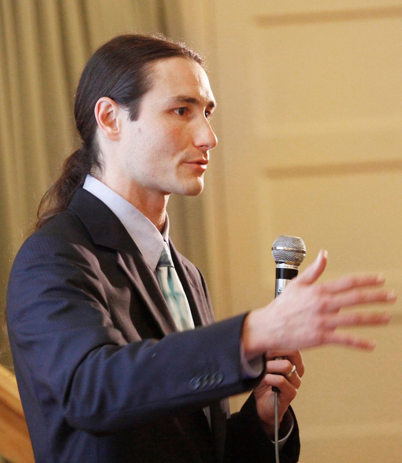 Dr. Dustin Sulak, who operates a medical marijuana practice through Integr8 Health LLC of Falmouth, speaks to more than 250 people at an educational forum Thursday at the Woodfords Club in Portland. Sulak talked about the drug's benefits and potential uses.
