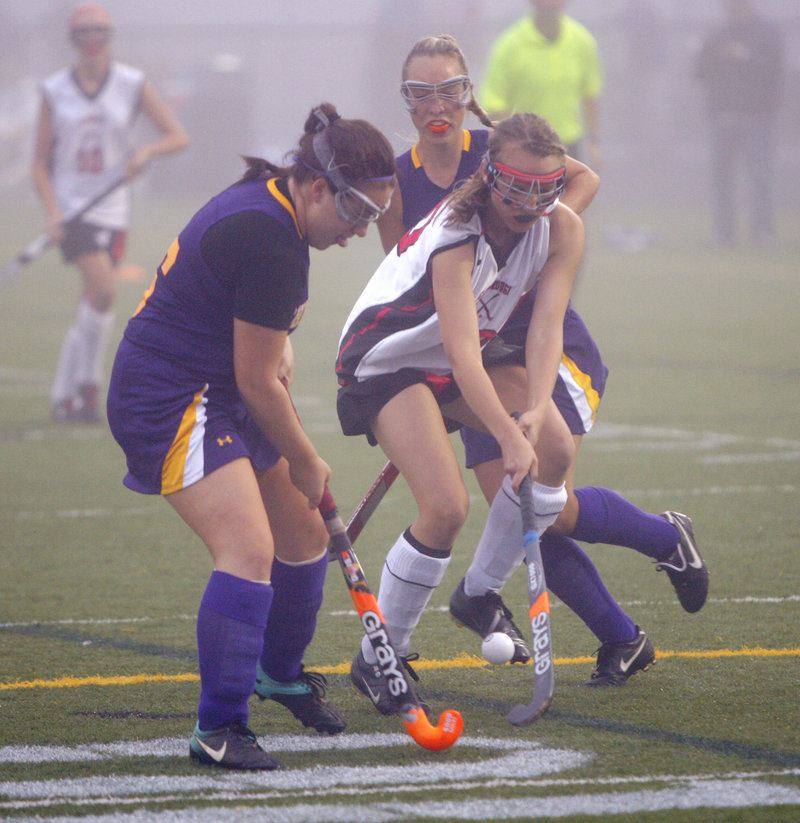 Annie DiLisio of Cheverus, left, and Grace Whelan of Scarborough attempt to control the ball Thursday night during Scarborough's 2-1 victory in field hockey.