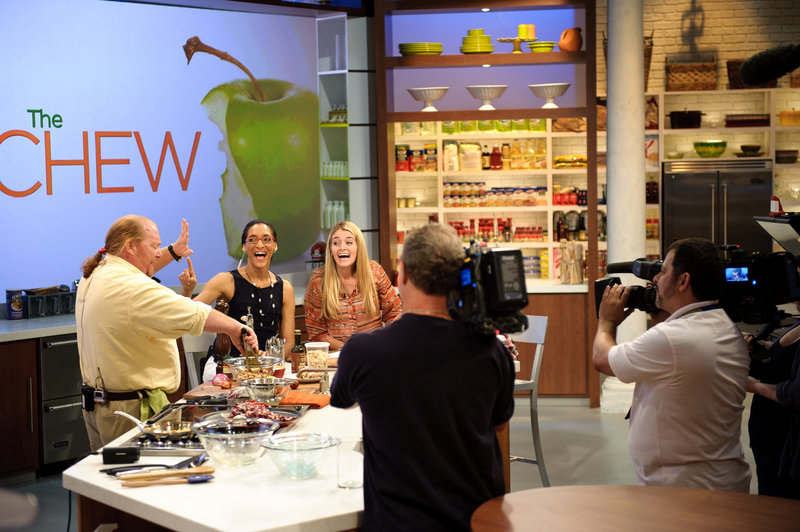 """Mario Batali, left, Carla Hall and Daphne Oz co-host """"The Chew."""" Not shown are co-hosts Michael Symon and Clinton Kelly."""