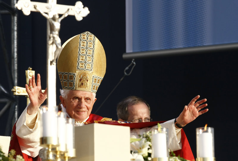"""Benedict XVI blesses the faithful at a vesper ceremony in Etzelsbach, Germany, on Friday. He also met with Muslim leaders and praised Martin Luther's """"deep passion."""""""
