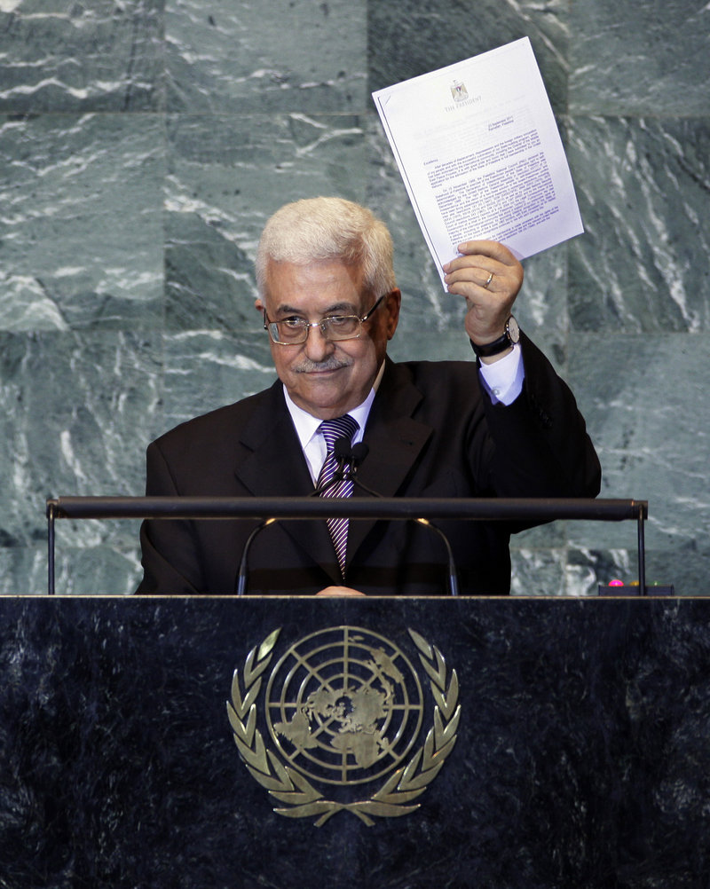 Palestinian President Mahmoud Abbas displays a letter seeking recognition of Palestine as a state during his address to the United Nations General Assembly on Friday.