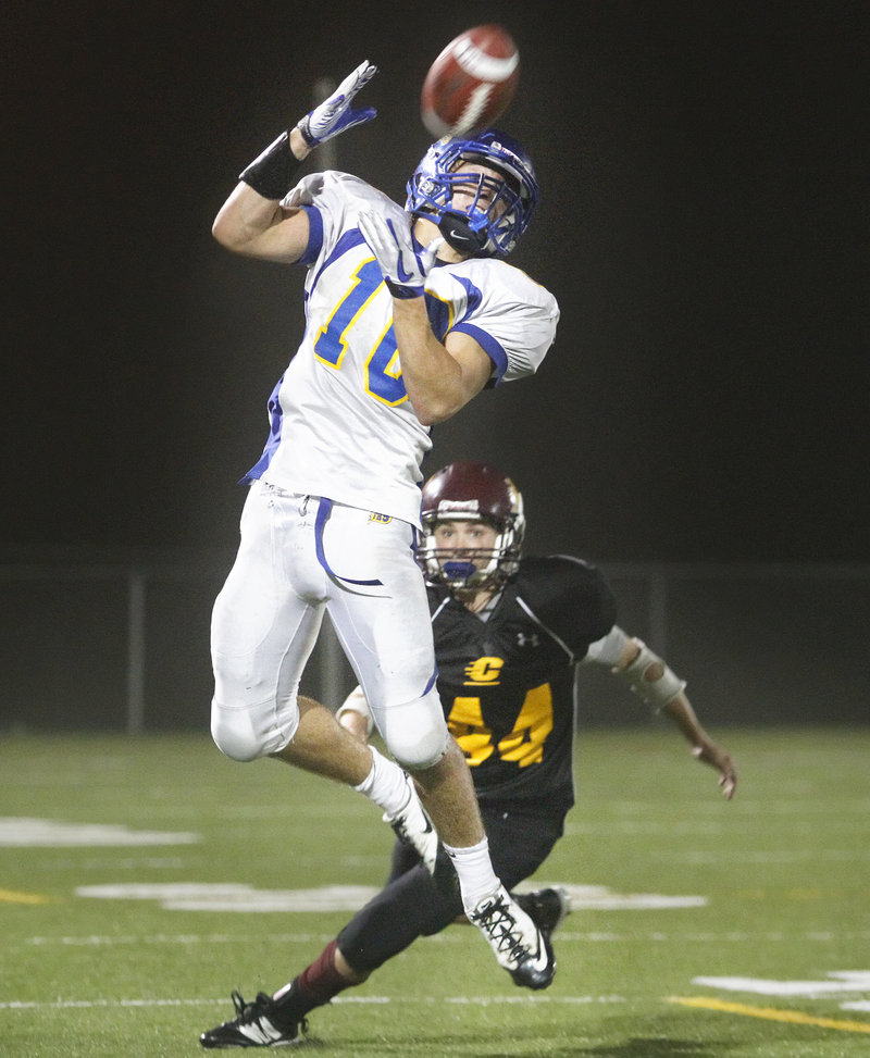 Will Sipperly of Falmouth leaps to make a catch in front of Cape Elizabeth's Donald Clark. Cape Elizabeth handed the Yachtsmen their first loss of the season, 28-6.