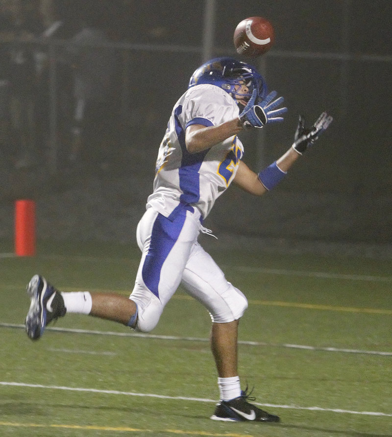 Alex Derhagopian bobbles the ball before making the catch for a touchdown on Falmouth's second play from scrimmage, the Yachtsmen's only points in Cape Elizabeth's 28-6 victory.