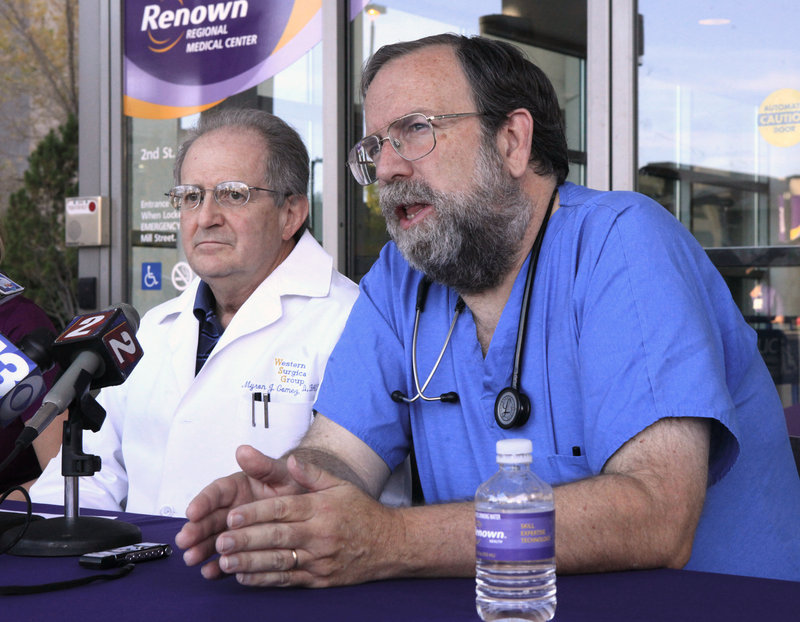 Dr. Mike Morkin, chief emergency room surgeon at Renown Regional Medical Center in Reno, Nev., shown speaking at a news conference on Sept. 17, is among those credited with saving the lives of many of those injured in the crash at an air show this month.