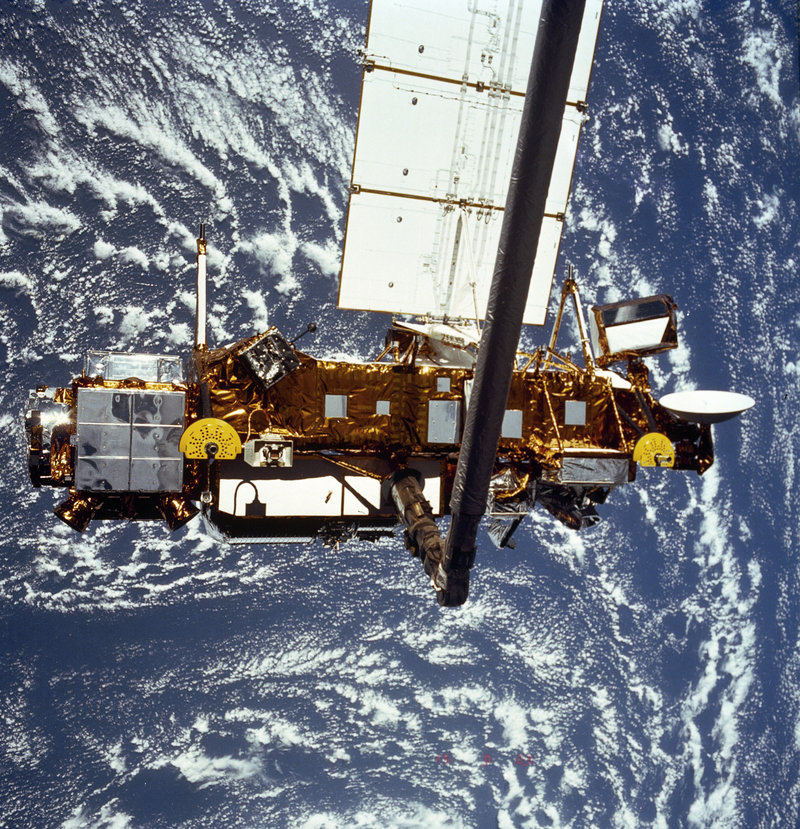 A NASA research satellite is shown during deployment from a space shuttle in 1991. The satellite fell to Earth overnight Friday, likely landing in the Pacific Ocean.