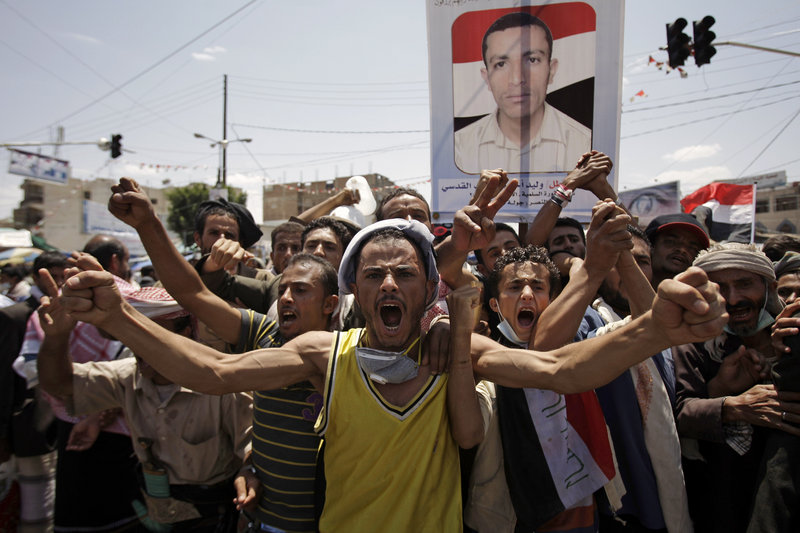 Protesters demand the resignation of Yemeni President Ali Abdullah Saleh, in Sanaa, Yemen, on Saturday.