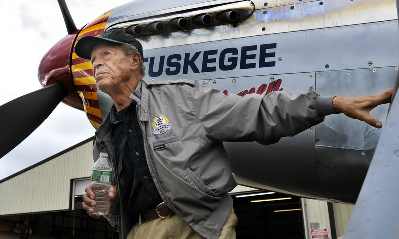 Jim Sheppard, 87, of South Portland checks out a Red Tail P-51C Mustang at the Biddeford airport Saturday. The World War II plane flew in to let Sheppard, a Tuskegee Airman, soar in the clouds again.