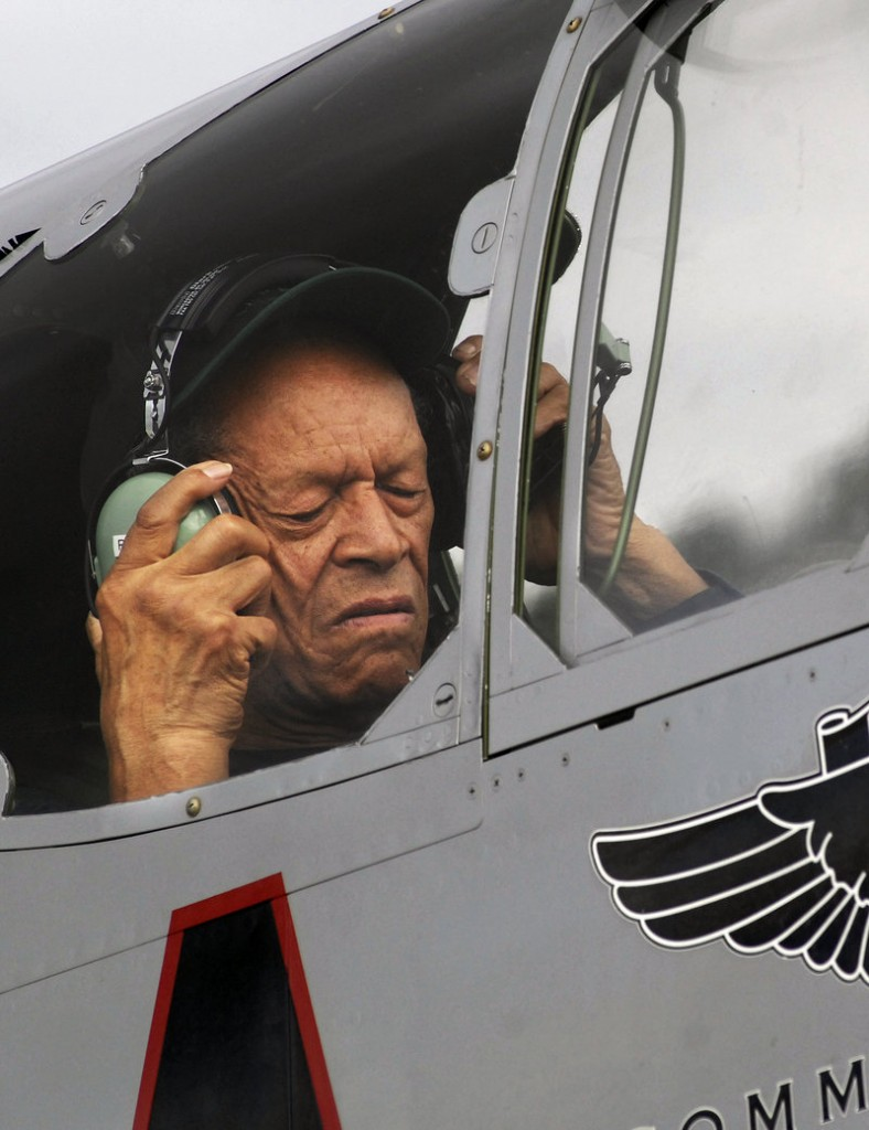 Jim Sheppard adjusts a headset aboard the Red Tail. The last time he flew in an airplane like it was 66 years ago at the end of World War II, during his combat service as a Tuskegee Airman, a member of the first all-black unit in what was then the U.S. Army Air Corps.