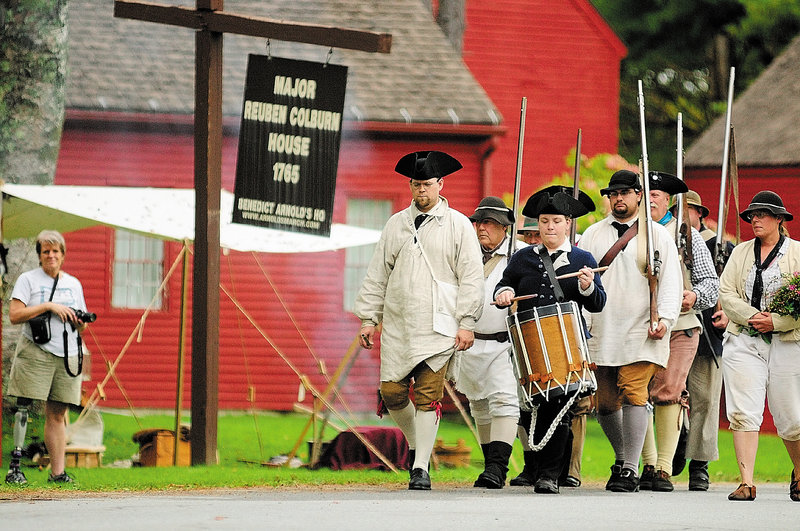 Drummer Katherine LaFlamme of Lisbon leads re-enactors in Pittston on Saturday. The group marked the anniversary of Benedict Arnold's arrival at Maj. Reuben Colburn's house.