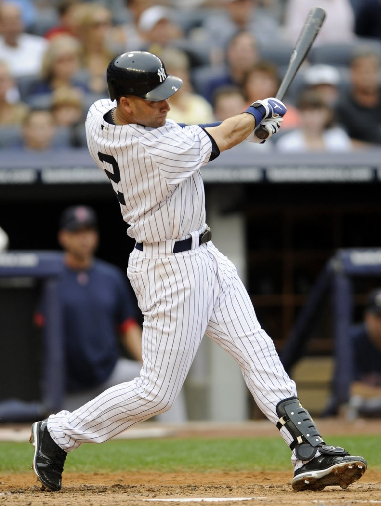 Derek Jeter follows through on a three-run homer in the second inning against Jon Lester and the Red Sox on Saturday at Yankees Stadium. Boston lost, 9-1.