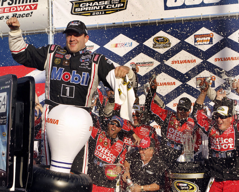 Tony Stewart and his crew celebrate his NASCAR Sprint Cup win at New Hampshire Motor Speedway in Loudon, N.H., on Sunday. Stewart now has a 7-point Chase lead.