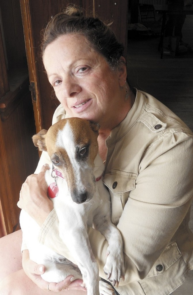 Cynthia Soma-Hernandez holds Lady Guinevere at the Pet Food Pantry, where she gets free food for her pets.