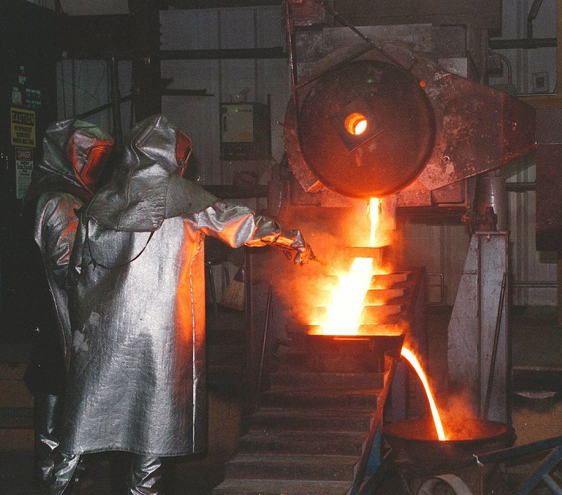 Workers make gold ingots at a facility in Nevada, where much of the nation's gold is mined. Many mining communities, such as Elko, have gotten an economic boost from the recent runup in gold prices, but fear the good times will not last. The city of Elko is putting off hiring, though newcomers are straining services.