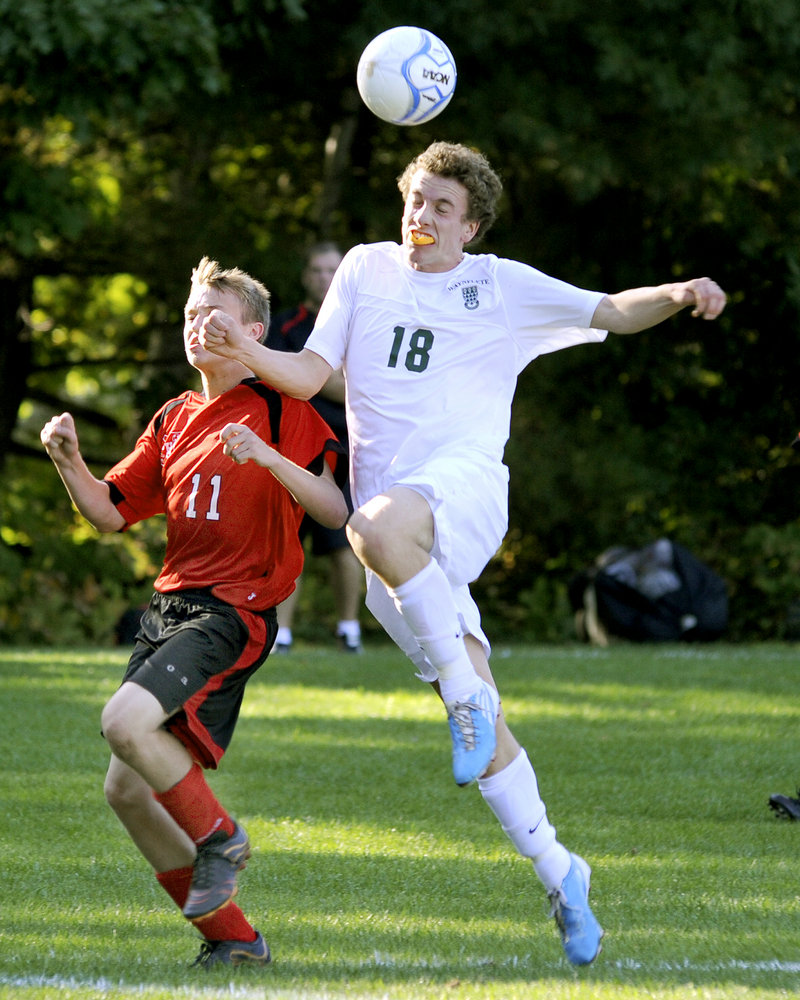 William Cleaves, right, of Waynflete makes a play on the ball in front of Wells' Tommy Cryer during Waynflete's 9-1 victory in Portland on Monday.