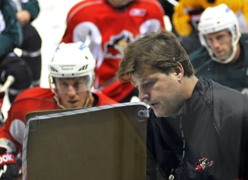 Pirates Coach Ray Edwards draws up a drill for the Pirates on opening day of the training camp Monday at the Cumberland County Civic Center. Some players will earn a spot on the Pirates' roster, while some will be placed with the ECHL's Gwinnett Gladiators.
