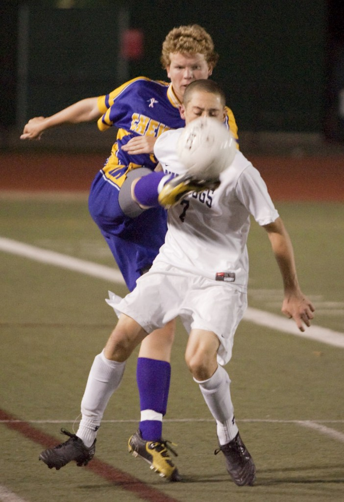 Jacob Smith of Cheverus wraps his foot around to knock the ball from Andrew Schwartz of Portland during Portland s 3-2 overtime victory Tuesday night.