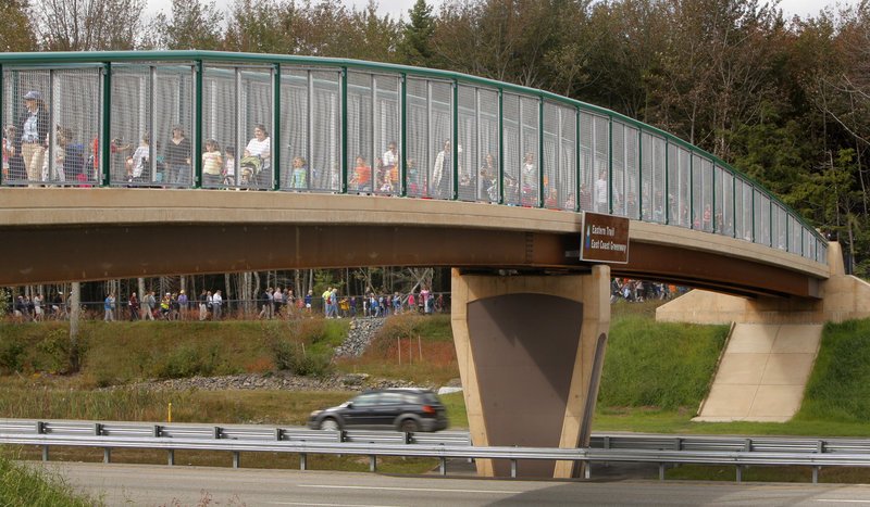 Pupils from Kennebunk Elementary School and Mildred L. Day School in Arundel cross the new Eastern Trail Bridge over the Maine Turnpike in Kennebunk on Wednesday to help mark the official opening of the span.