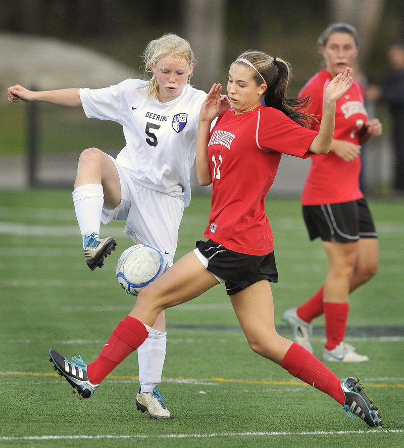 Meaghan Wells of Deering, left, competes with Taylor Leborgne of Scarborough in the first half of Scarborough s 3-2 victory. Scarborough (5-1-2) has a six-game unbeaten streak.