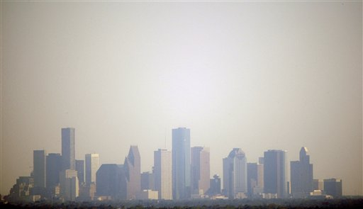 Smog in downtown Houston on Oct. 2, 2008. President Obama has put draft ozone regulations proposed by the Environmental Protection Agency on hold until 2013.