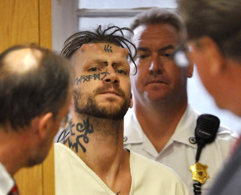Caius Domitius Veiovis appears at his arraignment Monday in Berkshire District Court in Pittsfield, Mass. In 2000, he was convicted in a Maine case that involved cutting a 16-year-old girl's back open.