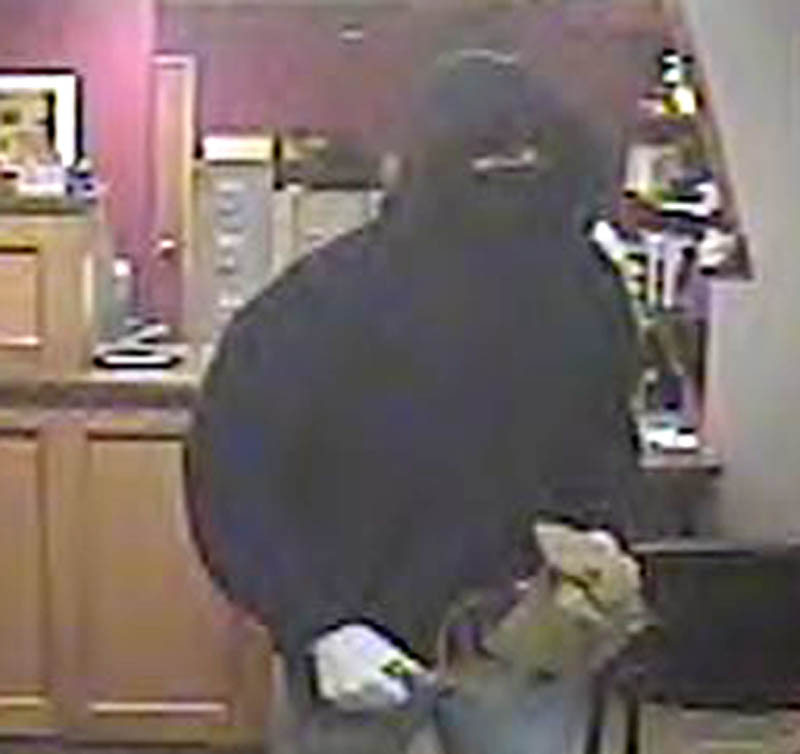 Contributed photo The person, shown in a security camera photograph, who robbed the HealthFirst Federal Credit Union in Waterville Thursday afternoon was in the building less than a minute, according to police.